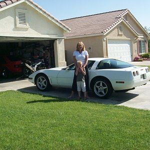 wife and son with vette