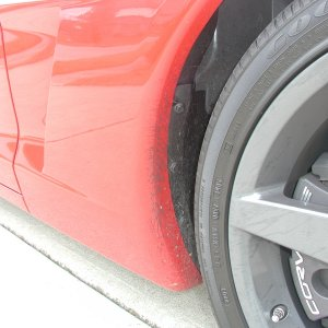 Signs of hard driving- front rubber on wheel well