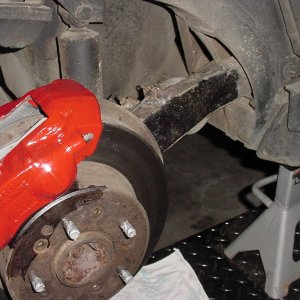 Parking Brake Bracket Moved to top of Trailing Arm